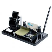 Desk set  including ballpoint pen- post-it pad- business card holder and mobile phone holder